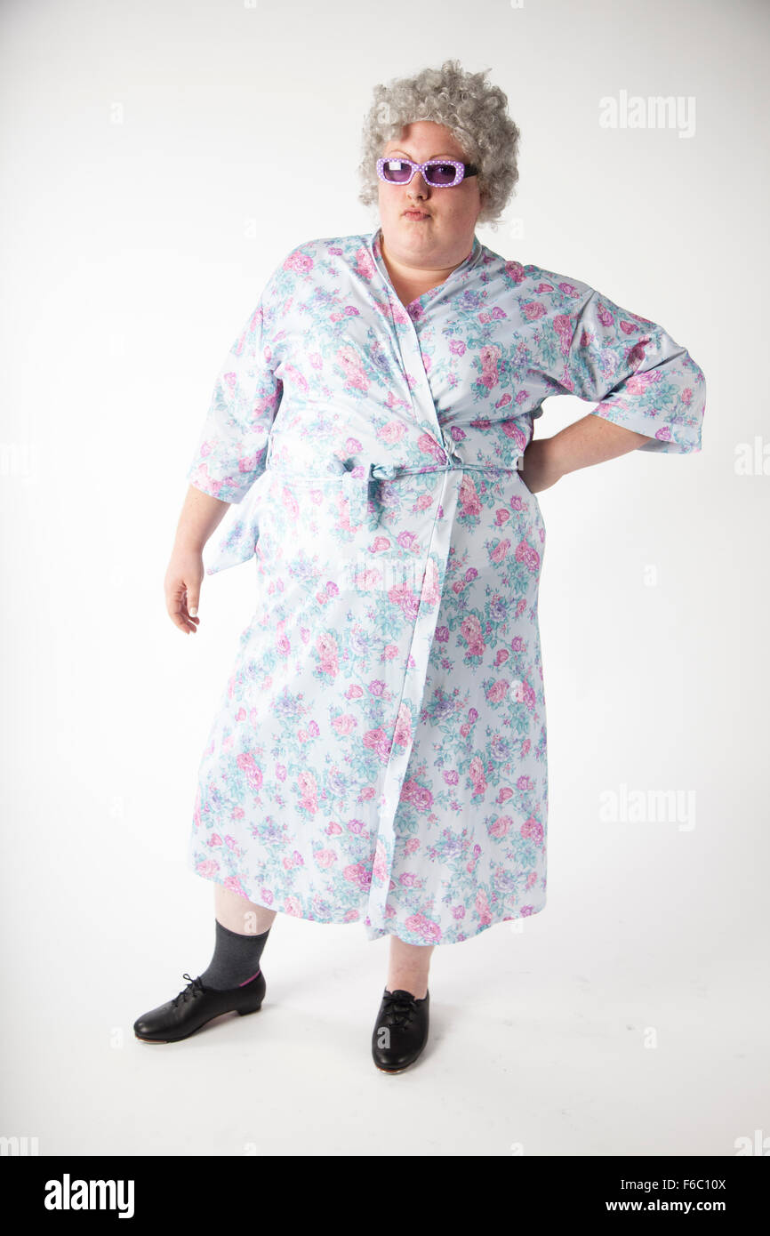 UNITED KINGDOM, WALES; 15 November 2015. Woman in OAP costume wearing tap shoes poses in a studio in a character - Stock Image