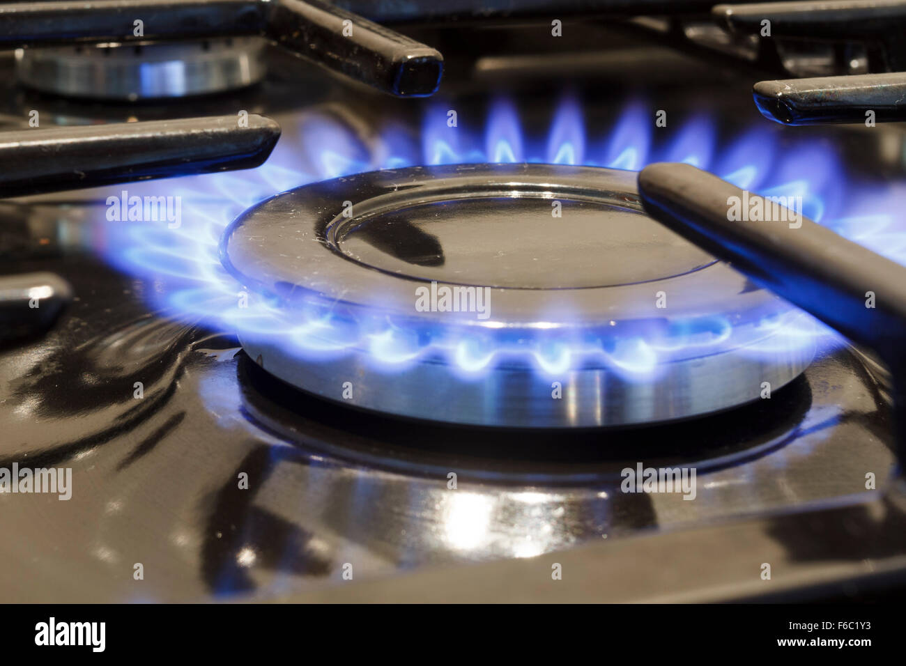 Gas flame on a cooker hob - Stock Image