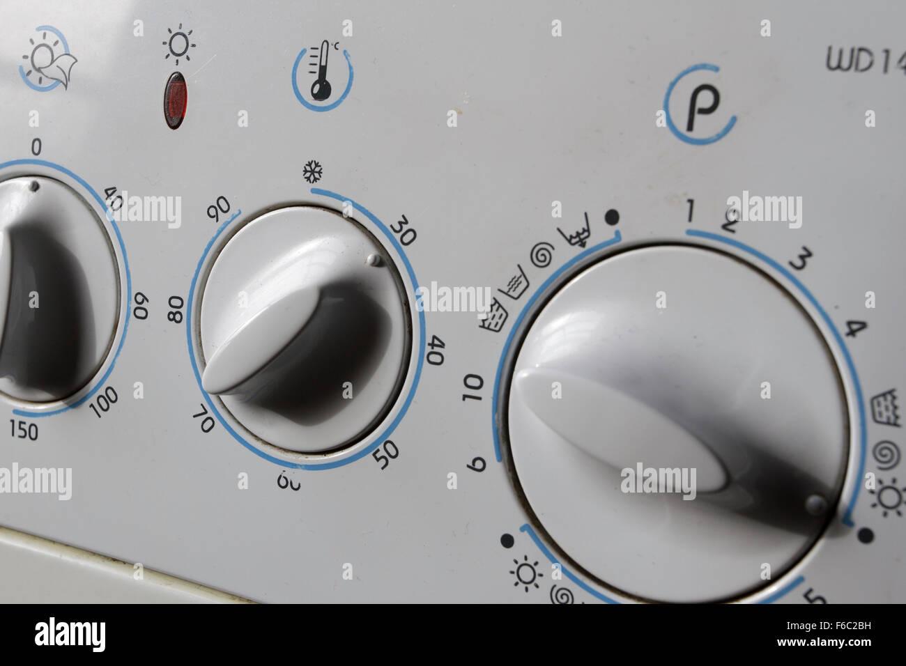 Old washing machine/dryer dials showing 30 degree centigrade wash - Stock Image