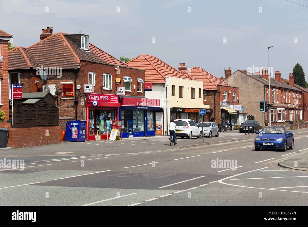 Parade of local shops, including Chapel Wines off-licence and Irlam Estates estate agent, on Liverpool Road, Irlam, - Stock Image