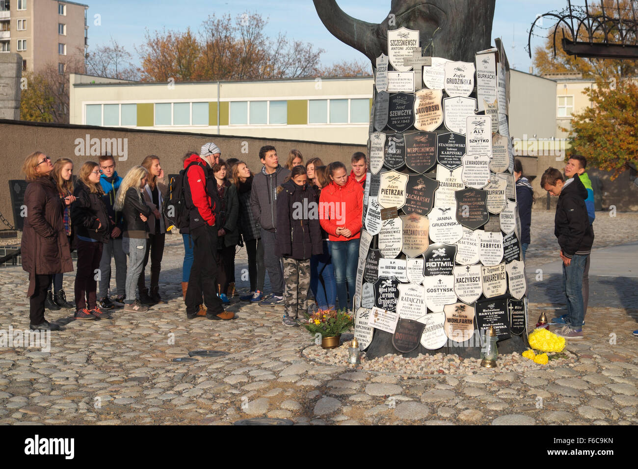 Warsaw Poland - Visitors at the entrance to the Pawiak prison used by the Nazi Germans during WW2 for torture and - Stock Image