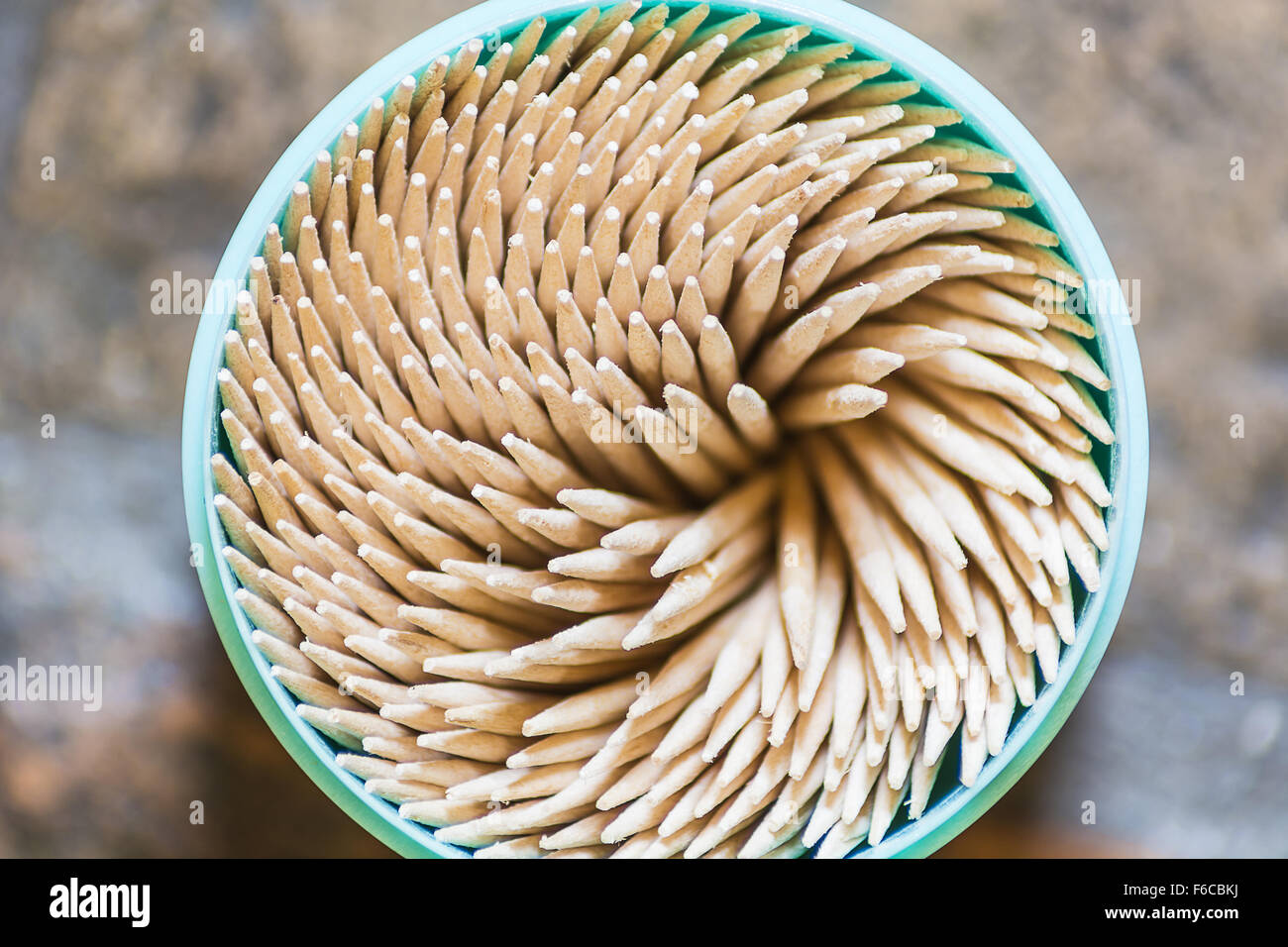 a bunch of toothpicks in a round box - Stock Image