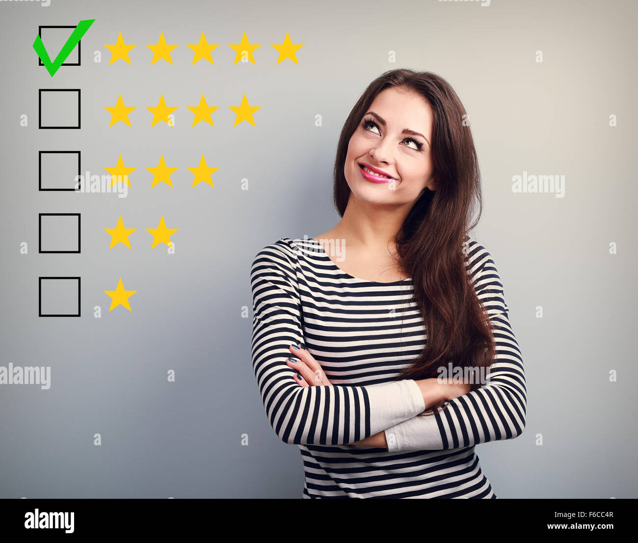 The best rating, evaluation. Business confident happy woman voting to five yellow star to increase ranking. On grey - Stock Image