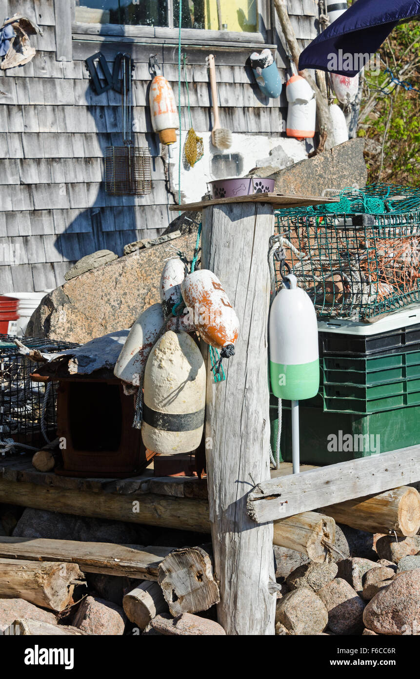 Fishing gear, inc. lobster pots and traps, on the deck of the Otter Creek Aid Society fish house, Otter Cove, Mt. Stock Photo