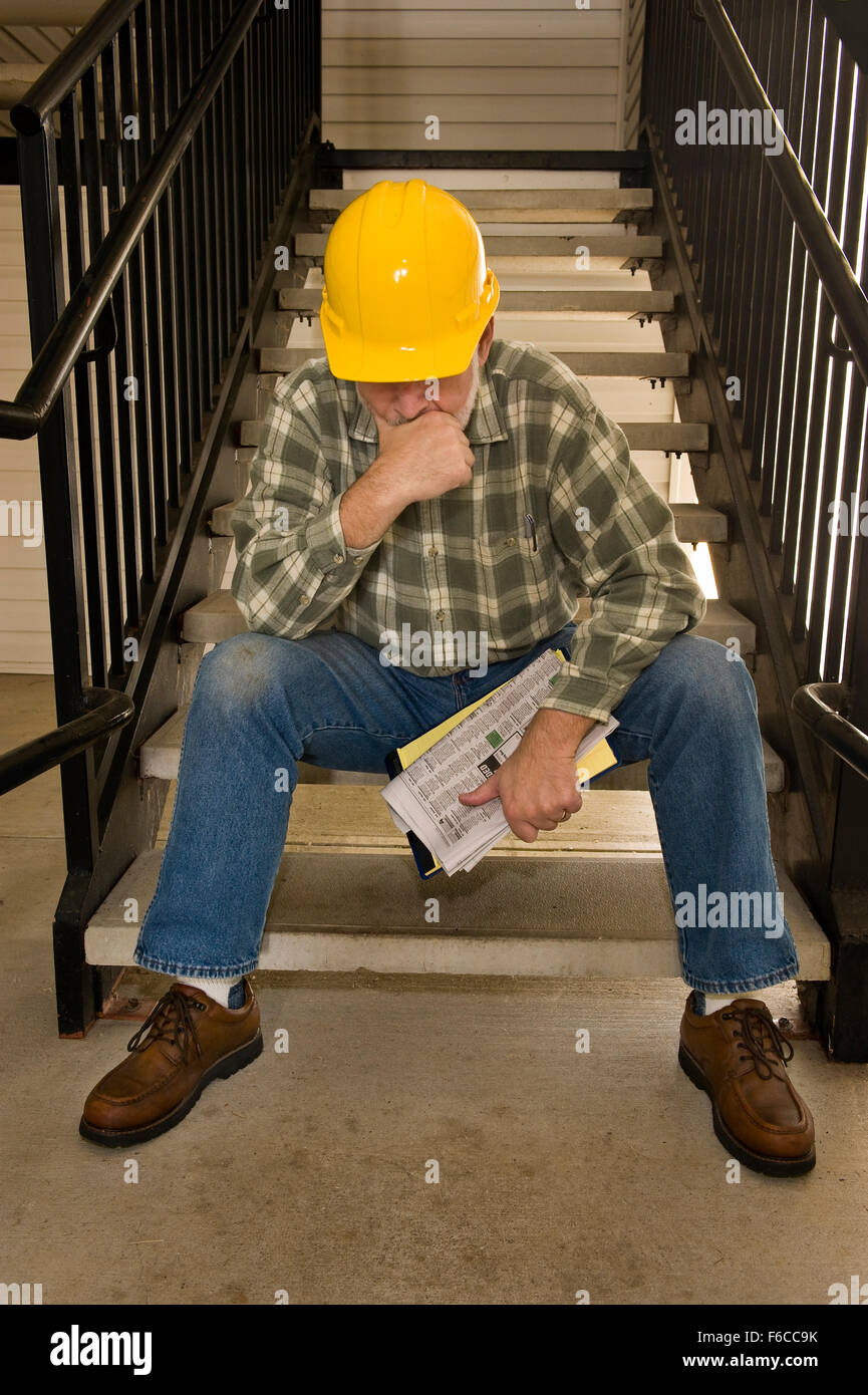 Laid Off Construction Worker - Stock Image