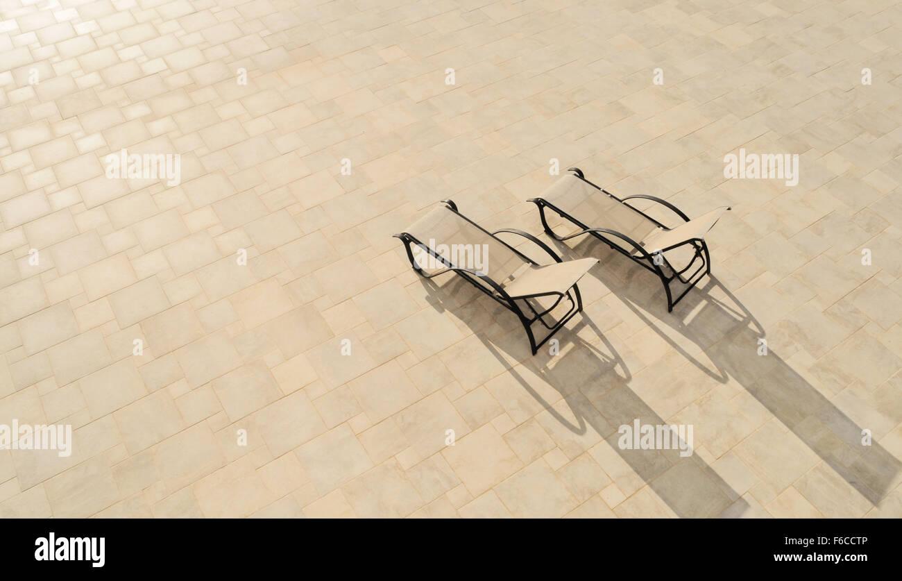 Sun loungers in Sun - Stock Image