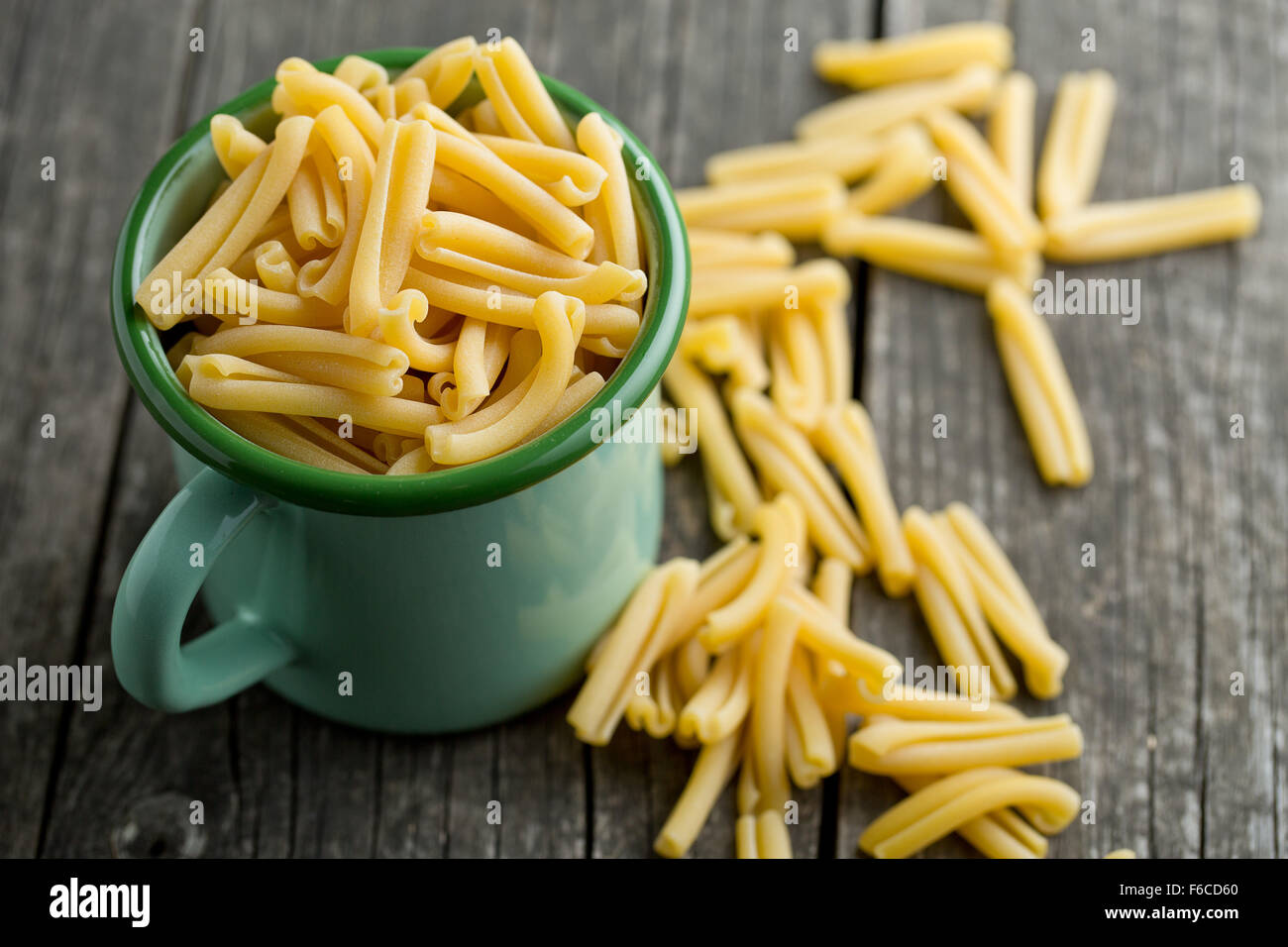uncooked pasta caserecce in cup - Stock Image