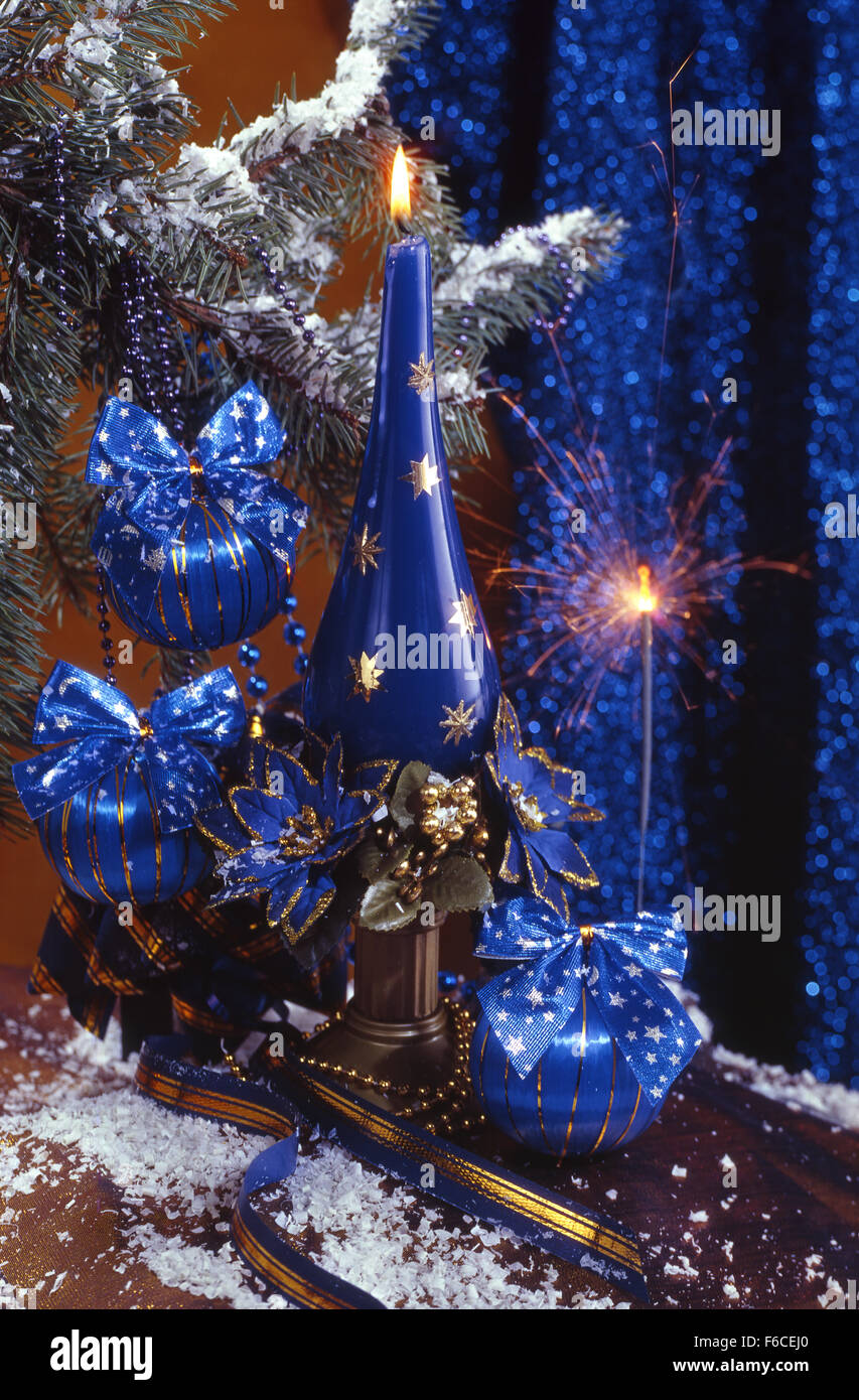 Festive New Year's, Christmas still life in blue-brown tones with blue Christmas balls, candles and a Bengal - Stock Image