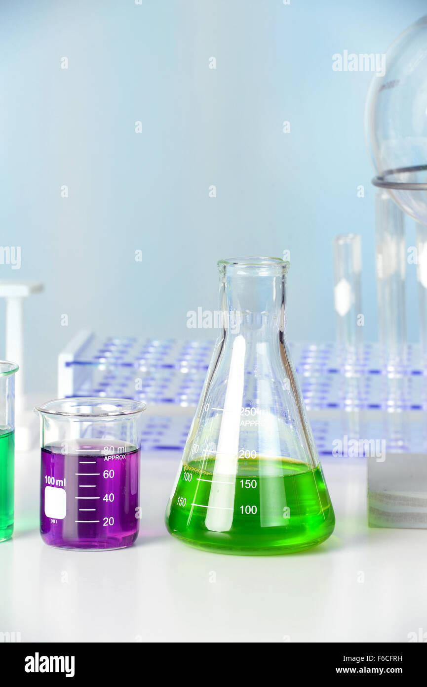 Laboratory glassware on white table in lab - Stock Image
