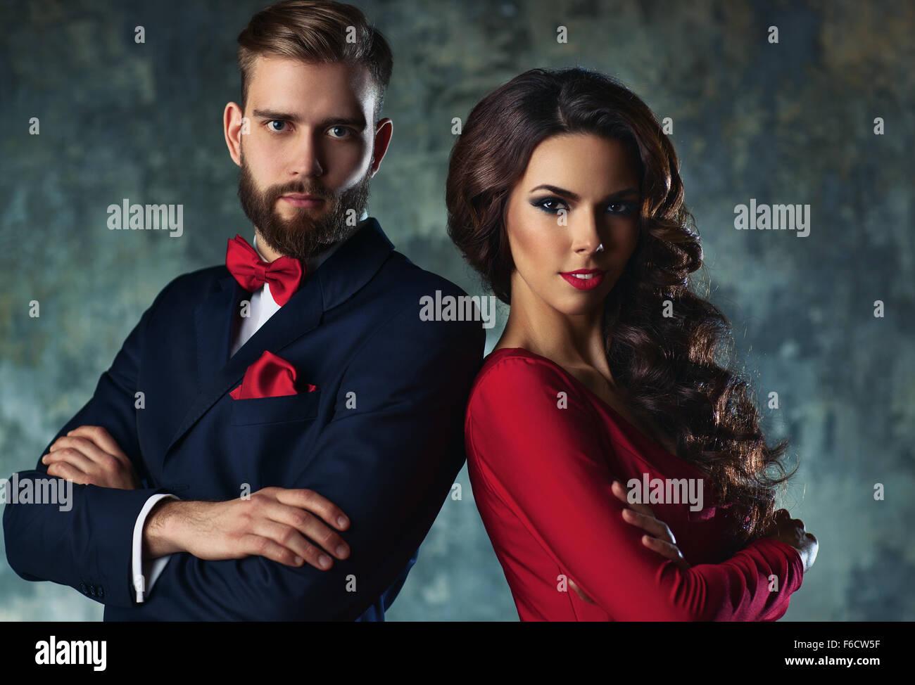 db44e55151157 Young elegant couple in evening dress portrait. Standing shoulder to  shoulder.