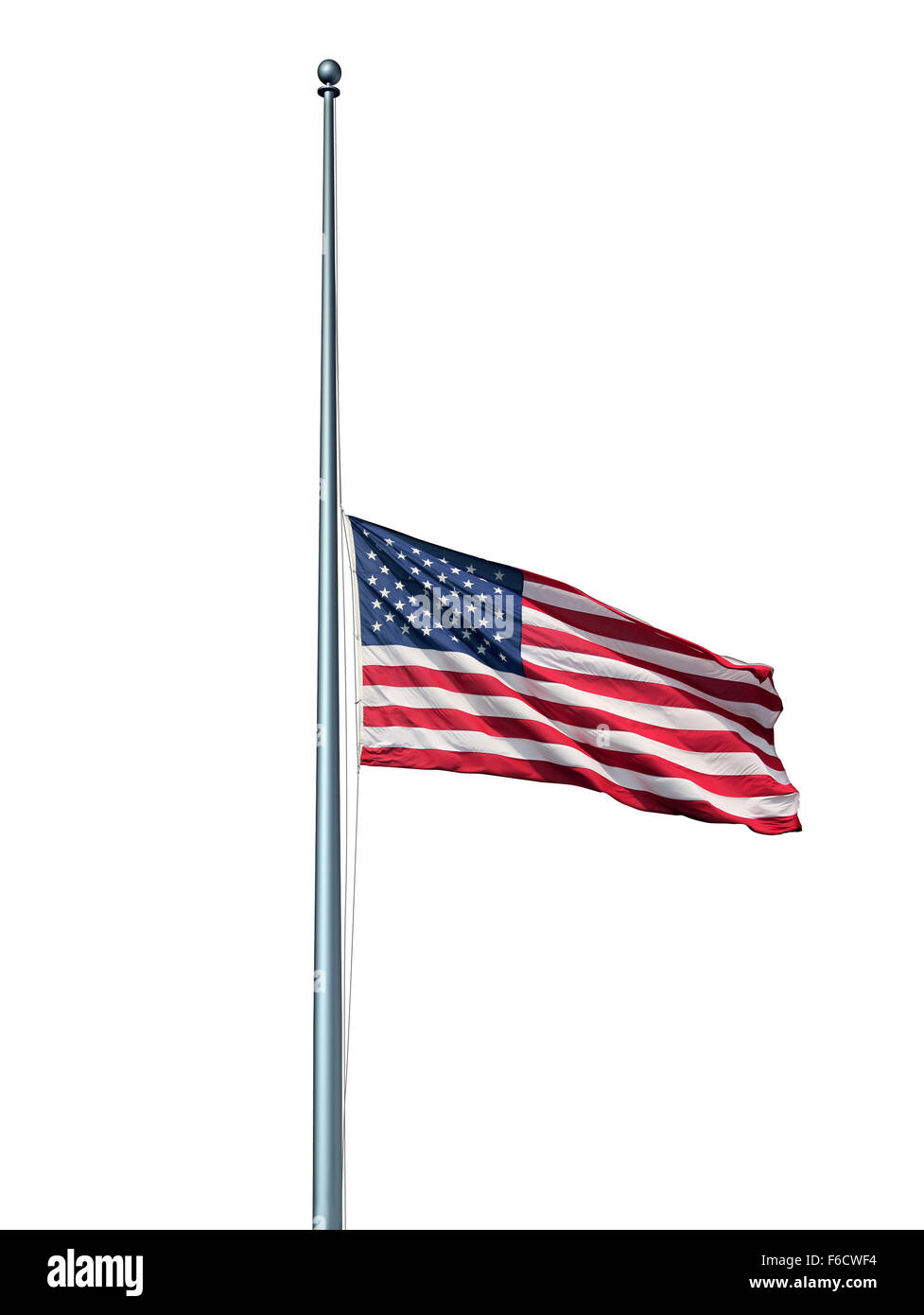 Half mast American flag isolated concept with the symbol of the United States flying at low level on the flagpole - Stock Image