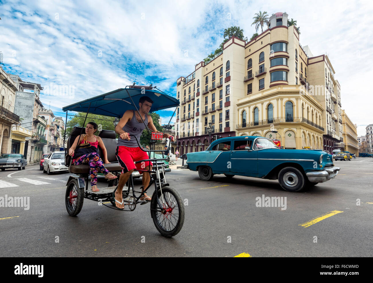 Oldtimer in the streetscape, pedicab, people taxi on the street intersection near the Hotel Telegrafo, Street Scene, - Stock Image