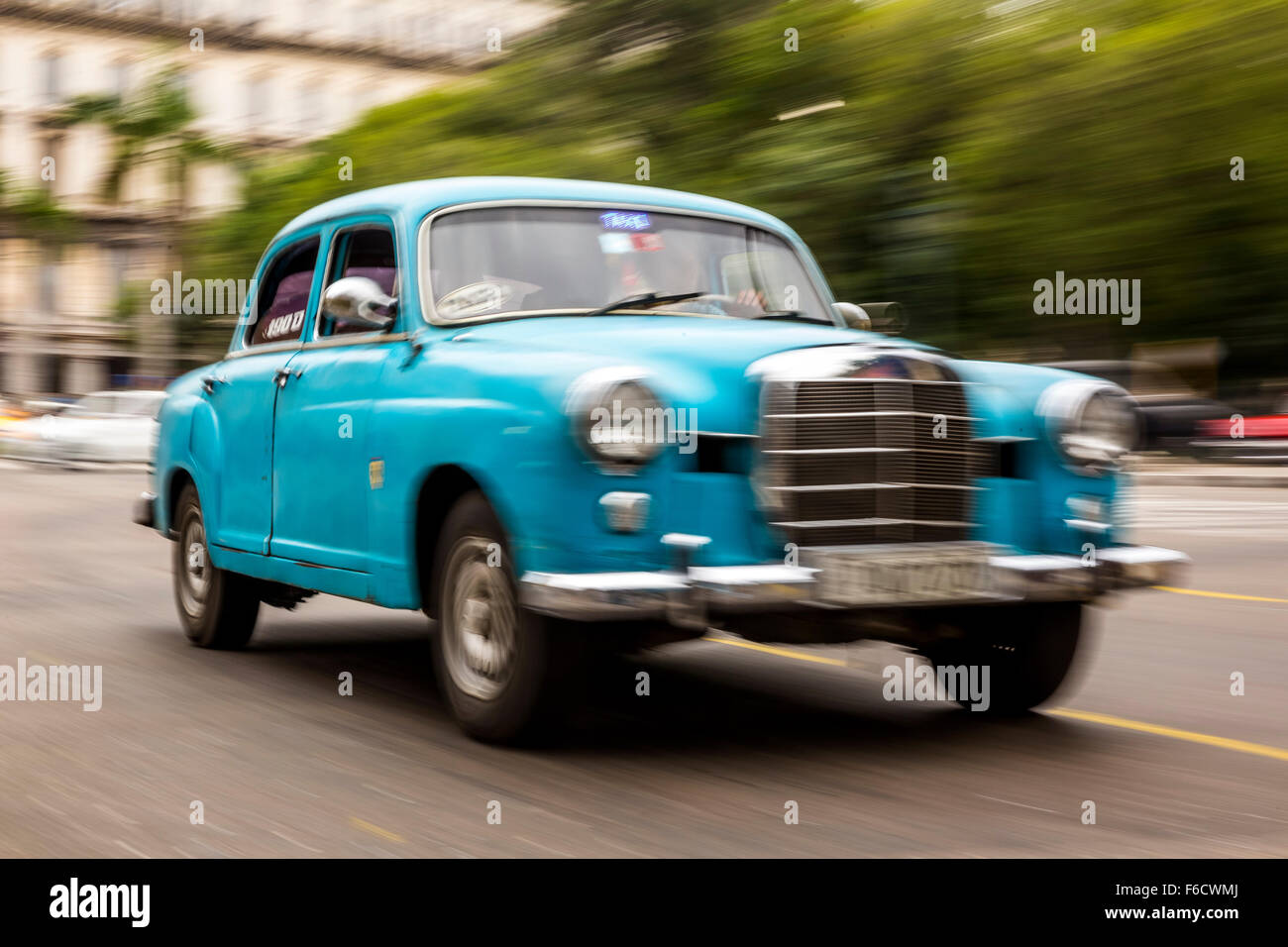Speed, blurred, traveling old car, classic car blue Mercedes on the ...