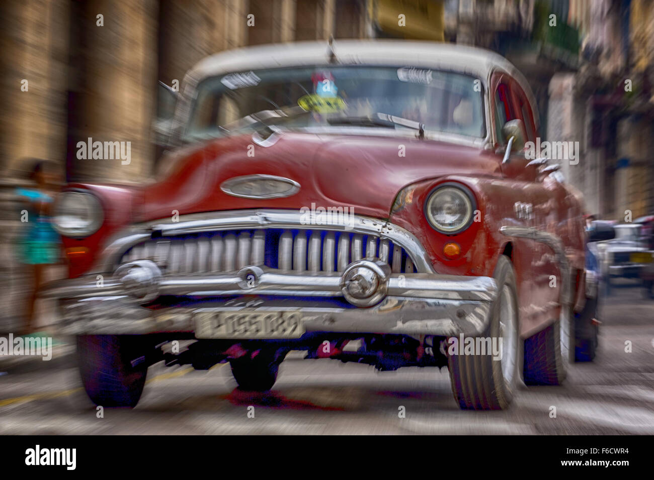 Speed, blurred, traveling old car, red vintage car on the streets, old American Roadcruiser on the streets of Havana, - Stock Image