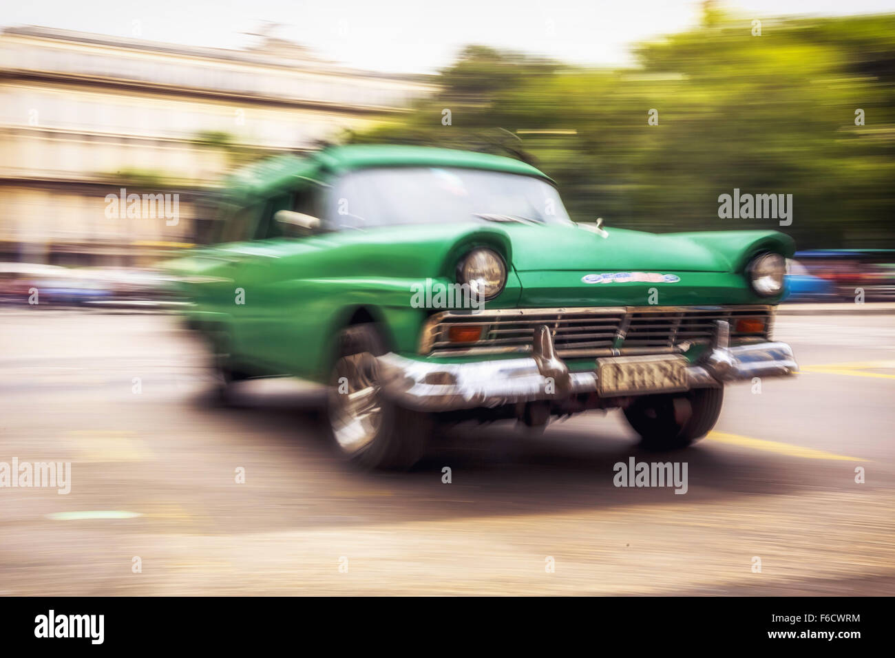 Speed, blurred, traveling old car, vintage green in the streets, old American road cruiser on the streets of Havana, - Stock Image