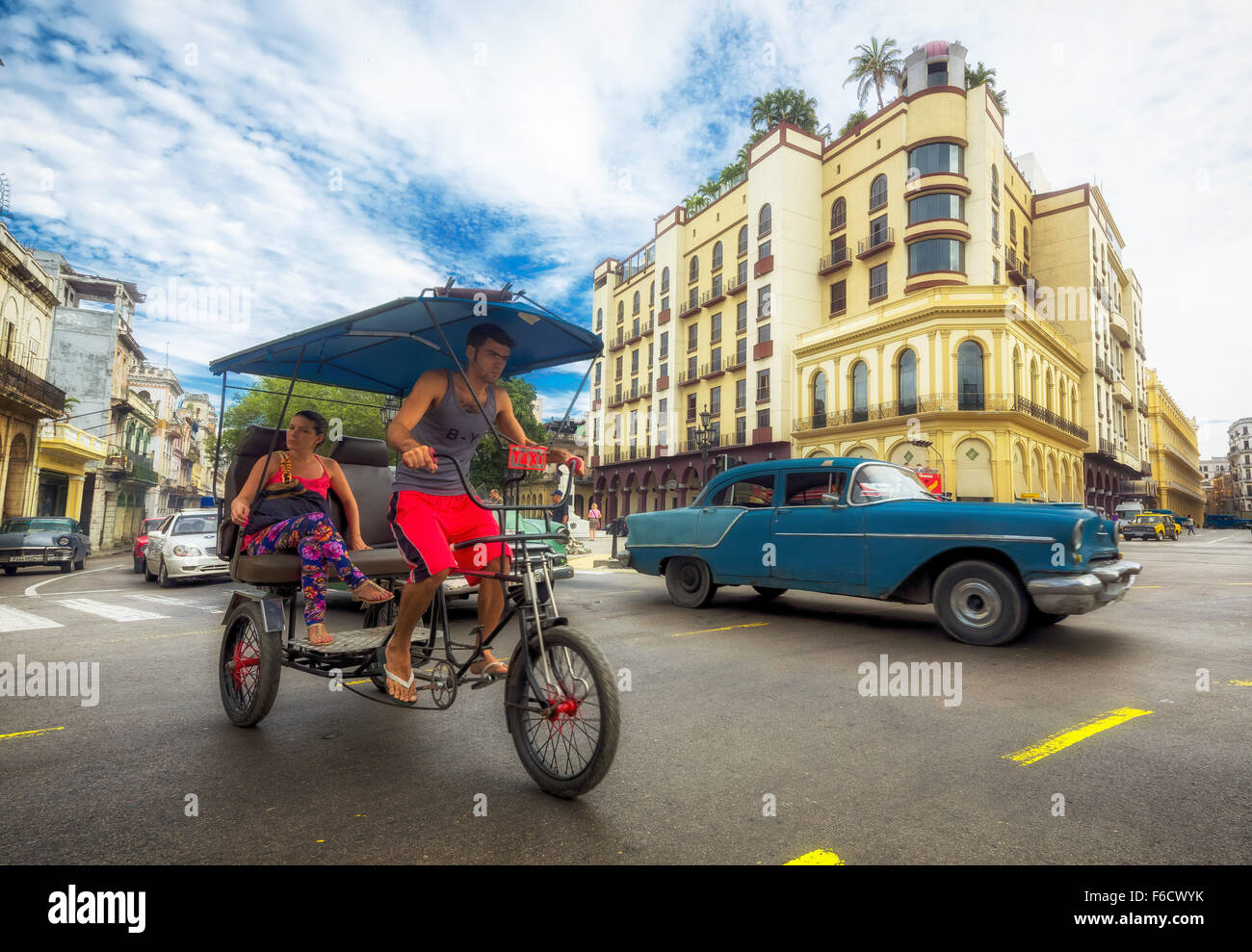 Oldtimer in the streetscape, pedicab, people taxi on the street intersection near the Hotel Telegrafo, La Habana, - Stock Image