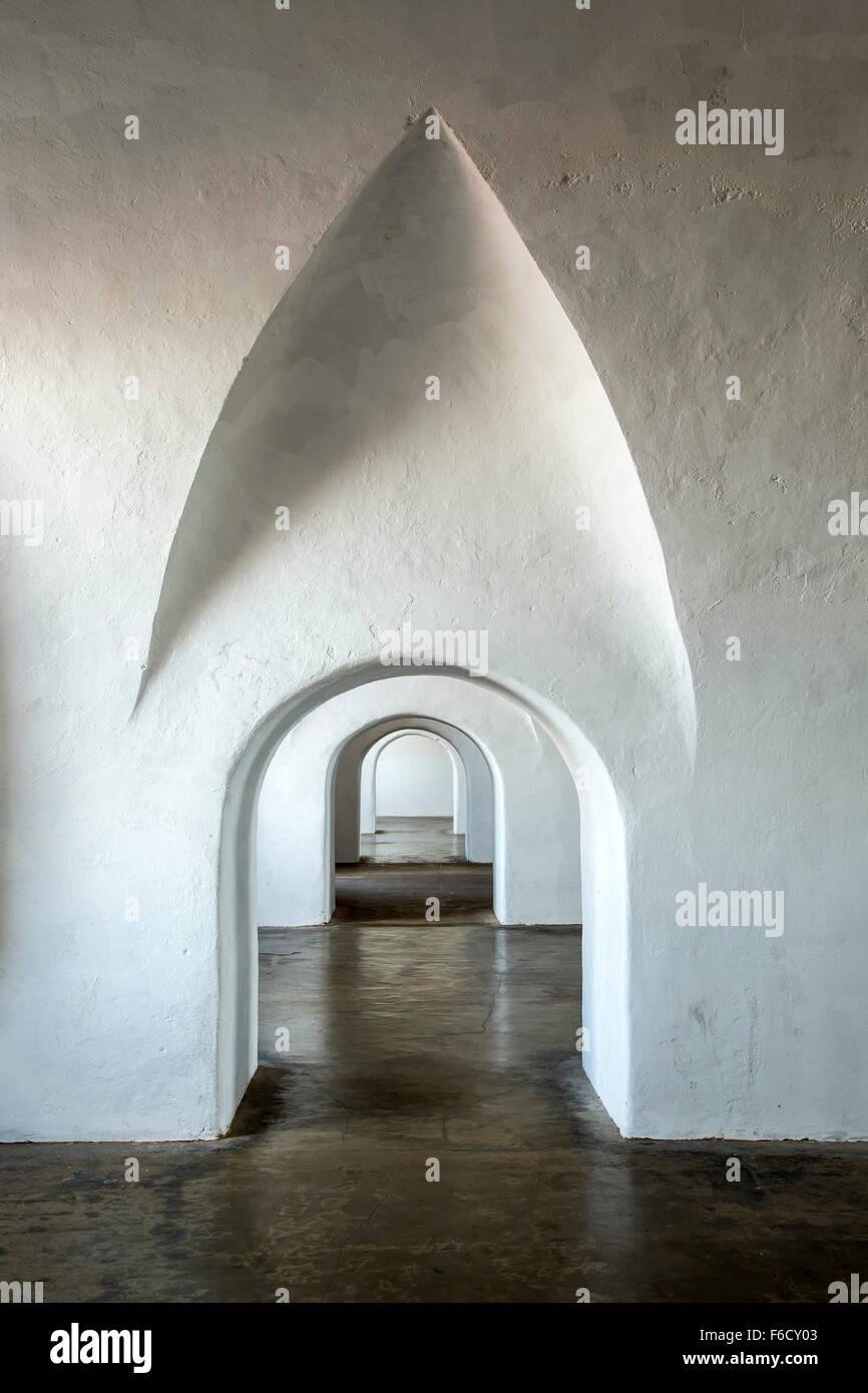 Repeating arched doorways, barracks, San Cristobal Castle, San Juan National Historic Site, Old San Juan, Puerto - Stock Image