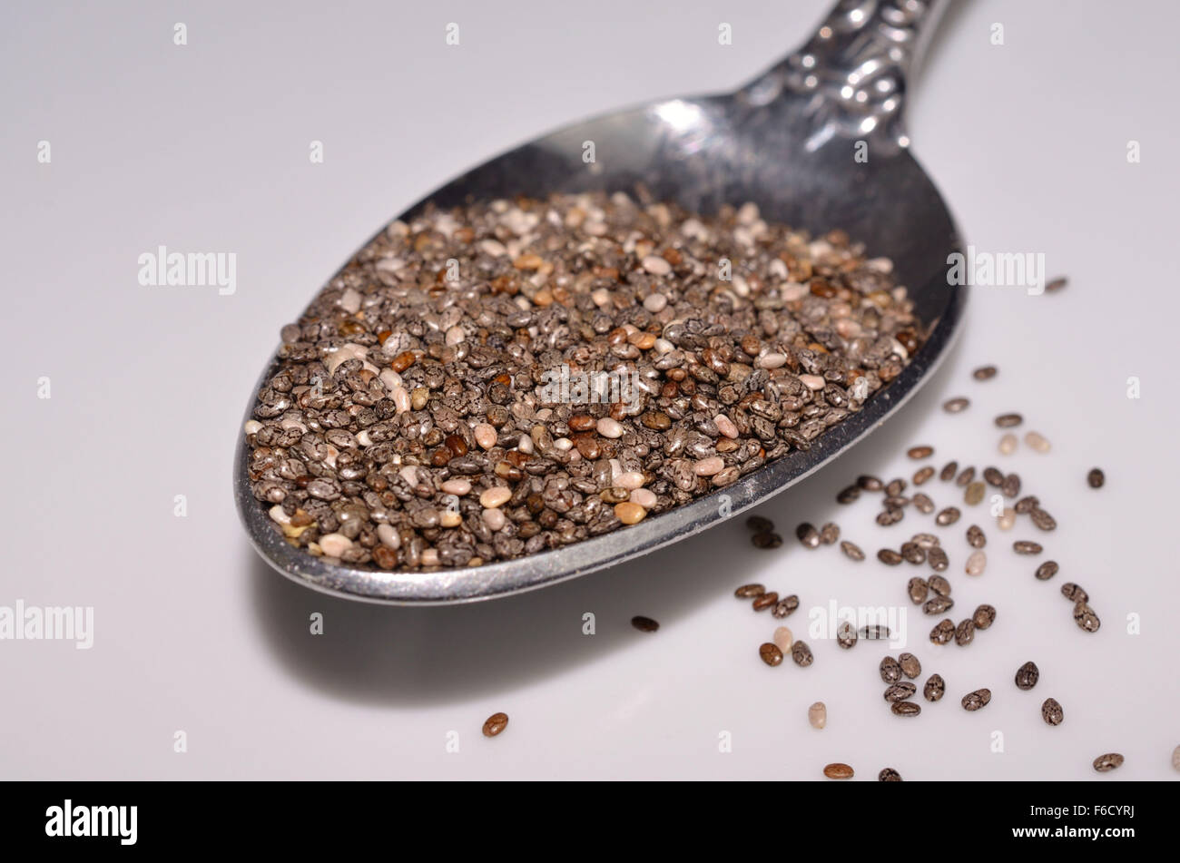 Healthy organic chia seed grains in a spoon - Stock Image