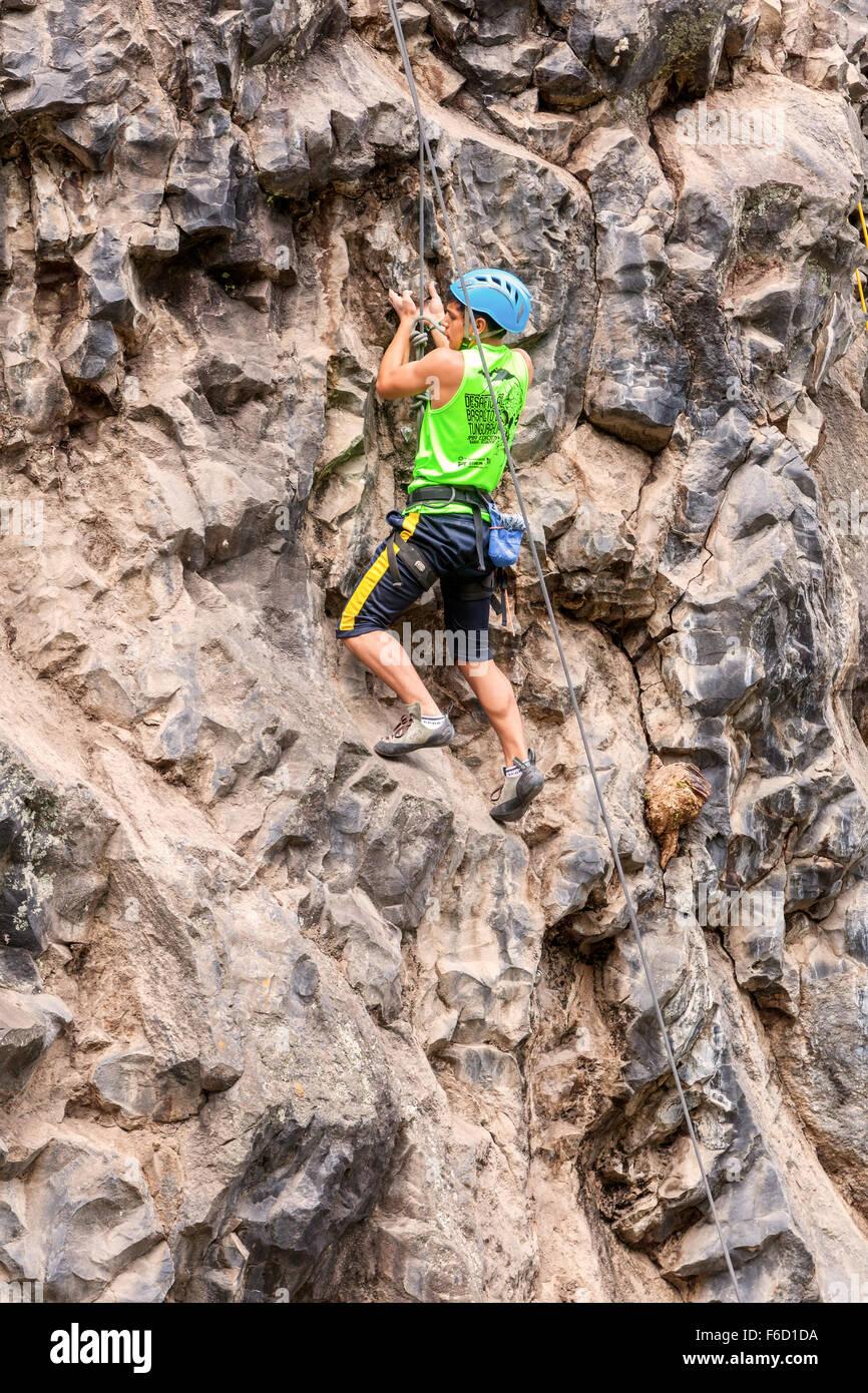 Banos, Ecuador - 30 November 2014: Basalt Challenge Of Tungurahua, Young Man Climbing On A Limestone Wall  In Banos - Stock Image