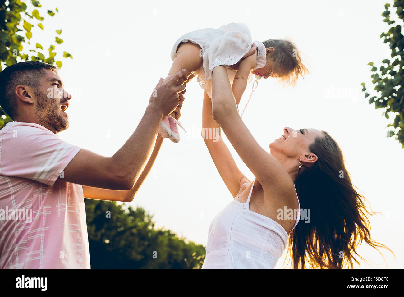 Parents and kid spending time - Stock Image