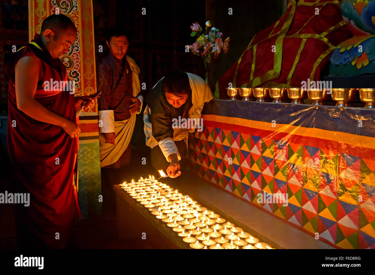 Ceremony of igniting 1000 butter lamps at the buddhist monastery of the Tashichho Dzong, Thimphu, Bhutan - Stock Image