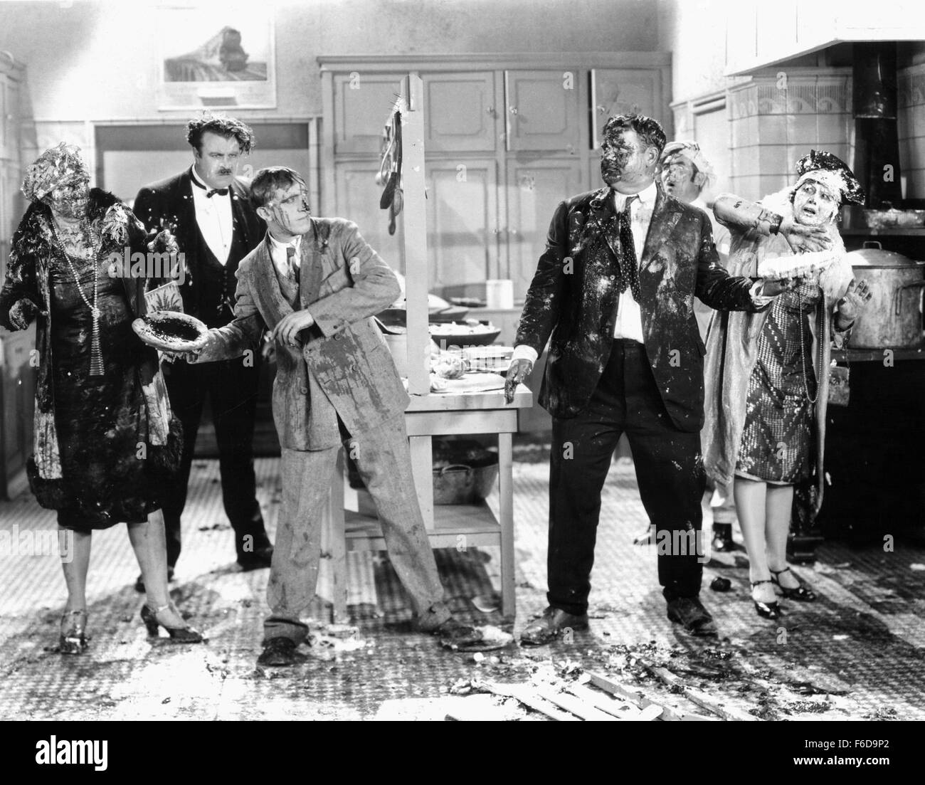 Jan. 1, 1920 - Kay Deslys, Tiny Sandford, Stan Laurel, Oliver Hardy and Anita Garvin on-set of the Film, Their Purple Stock Photo