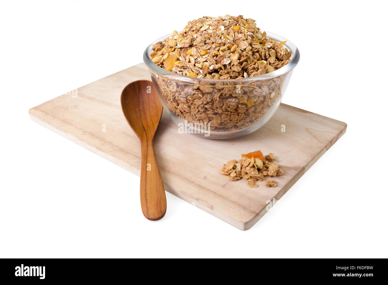 Granola cereal with dried fruits and wooden spoon isolated on white background Stock Photo
