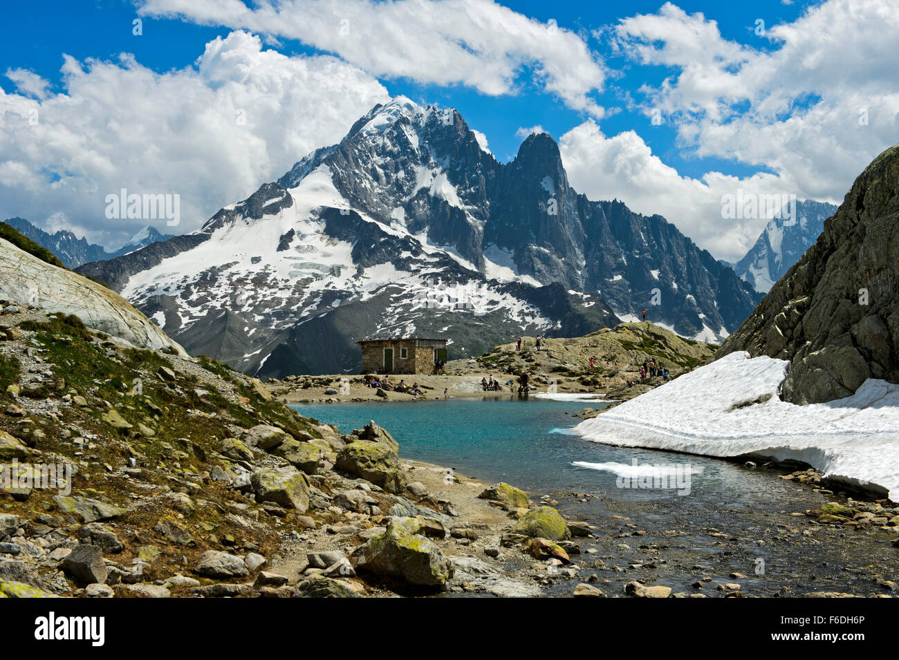 mountain lake Lac Blanc in the Aiguilles Rouges National Nature Reserve, peak Aiguille Verte and Les Drus behind,Chamonix,France - Stock Image