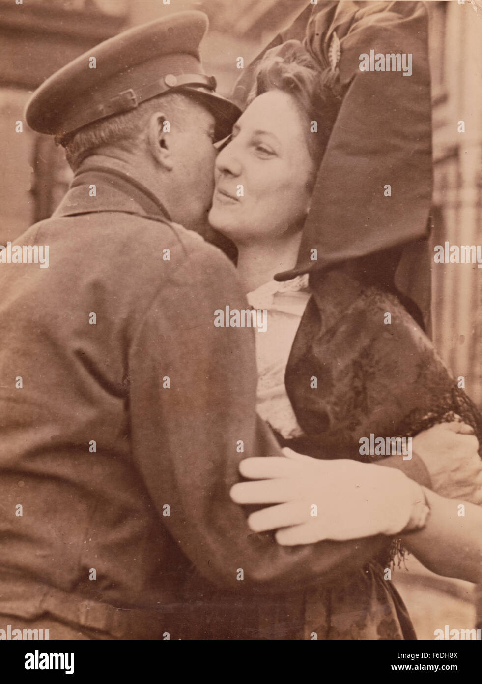 702. Lieutenant General Jacob l. Devers. Sixth US Army Group kisses a French Alsatian woman The Liberation Ceremony Stock Photo