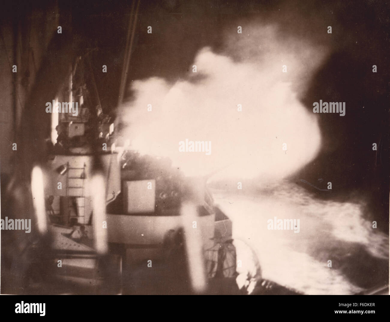 "710. HMS Norfolk attacks. The flash of the firing of the 8"" guns. Action off the coast of Norway 12th Jan 1945. Stock Photo"