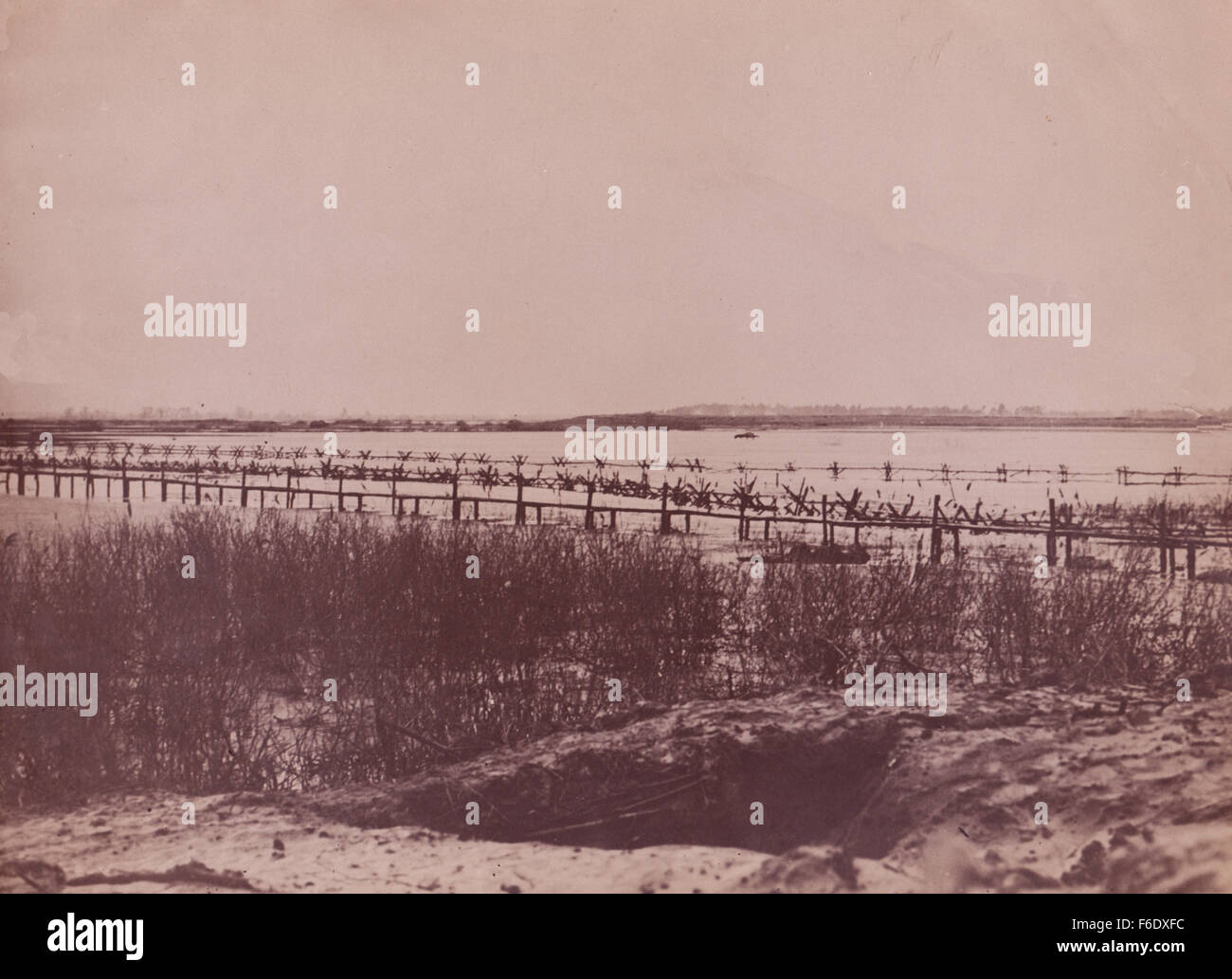 WW2 Normandy sea defences of barbed wire and sea mines. Stock Photo