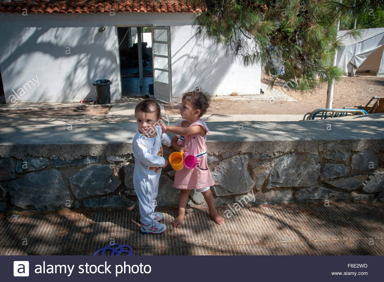 Children playing at PIKPA refugee camp in Lesbos, Greece. PIKPA is run by the 'Village of Altogether'. - Stock Image