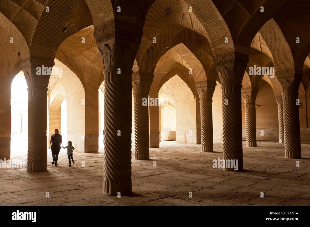 Mother with child in Vakil Mosque prayer hall, Shiraz, Iran - Stock Image