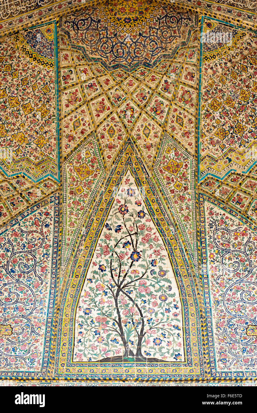 Wall with intricately painted tiles, floral pattern, Vakil Mosque, Shiraz, Iran - Stock Image