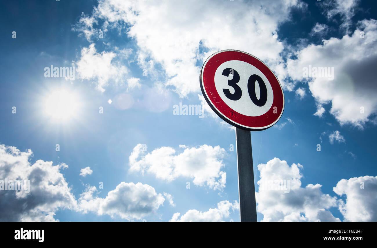 sign speed limit sunlit Stock Photo