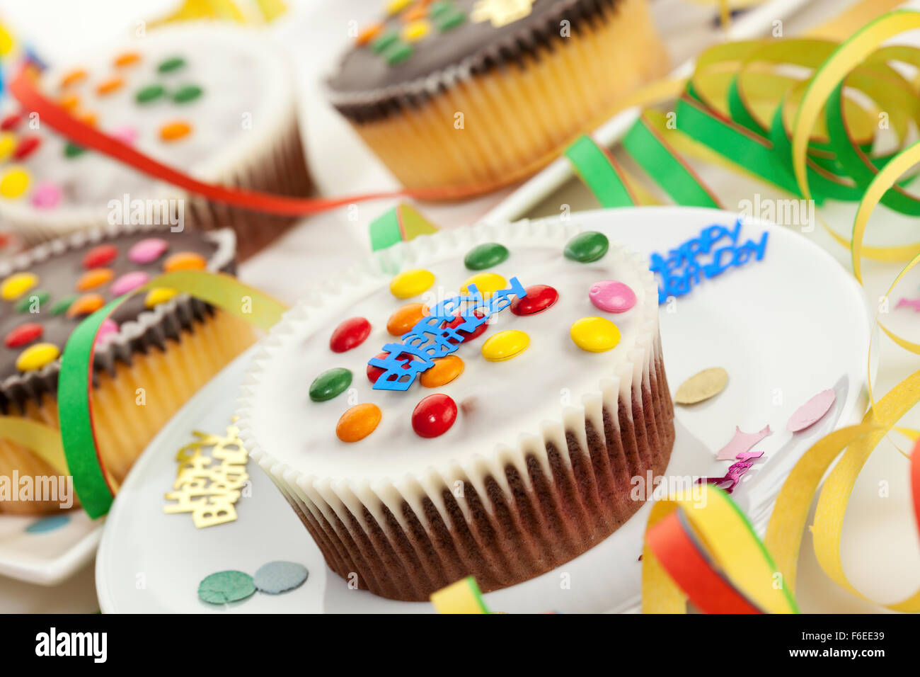 Birthday cakes and streamers - Stock Image