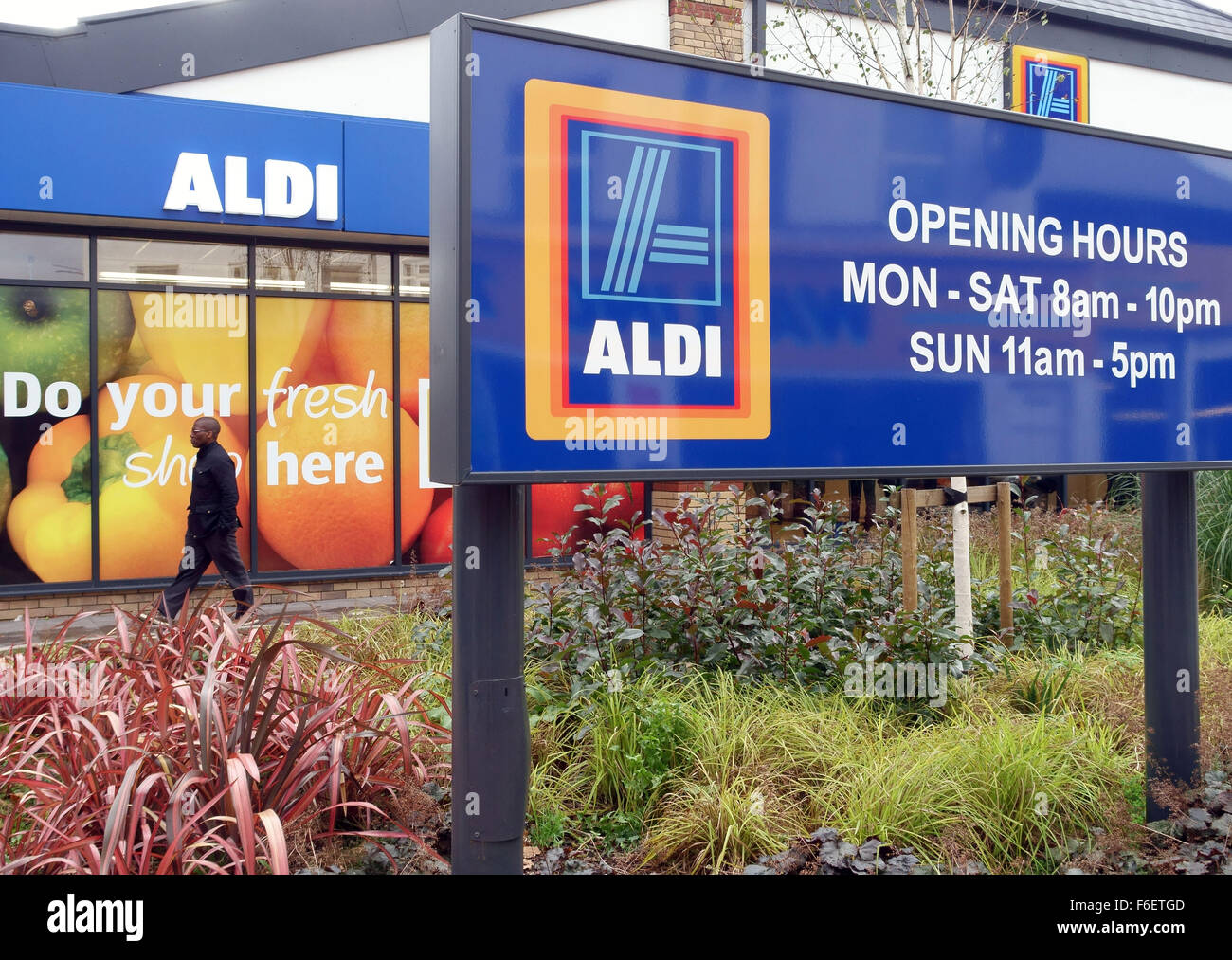 Sign on Aldi supermarket, London showing store's opening hours Stock