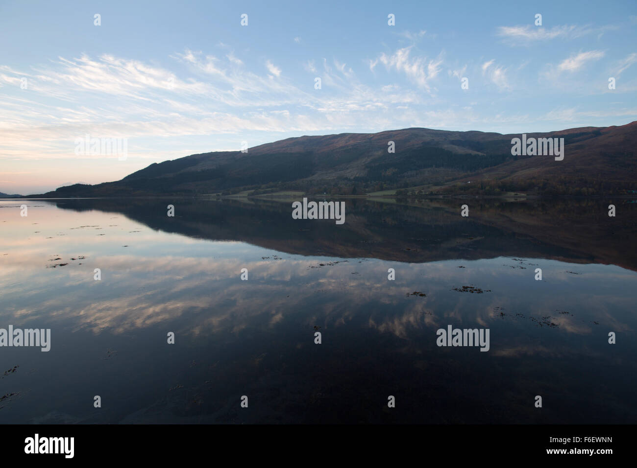 Area of Glen Coe, Scotland. Picturesque dusk view of Loch Leven with North Ballachulish in the background. - Stock Image