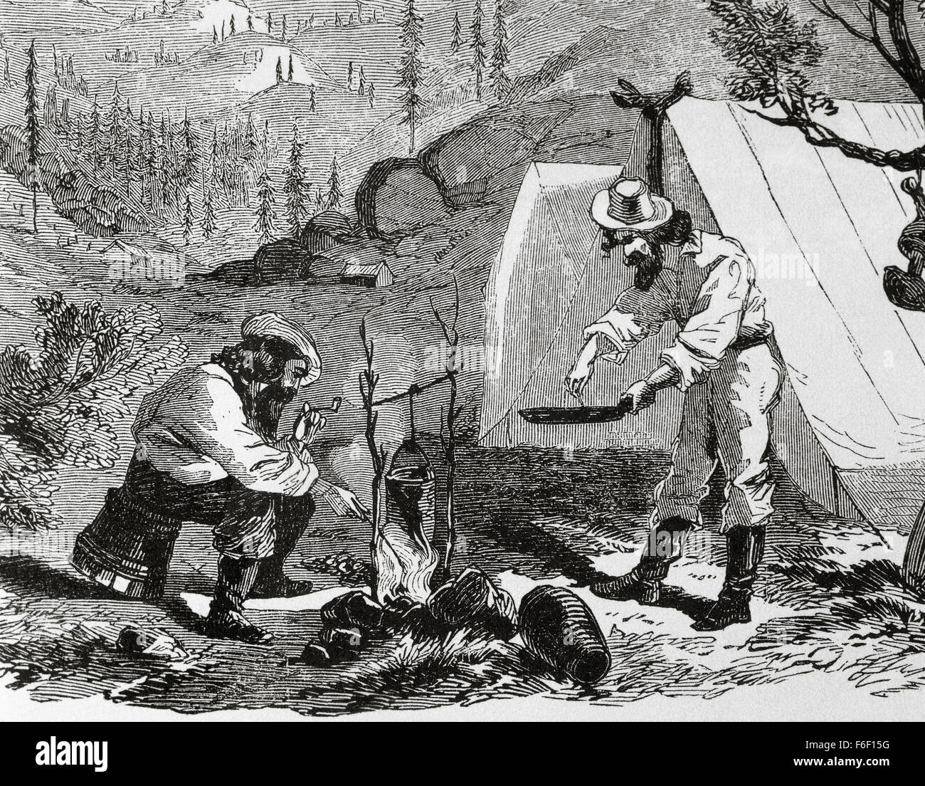 USA. Gold Rush. 19th century. Gold prospectors cook at the camp by night. Engraving at 'Harper's Weekly', - Stock Image