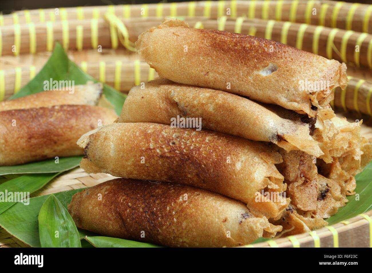 Serabi Solo, Javanese pancakes of coconut milk with chocolate sprinkles added then rolled. - Stock Image