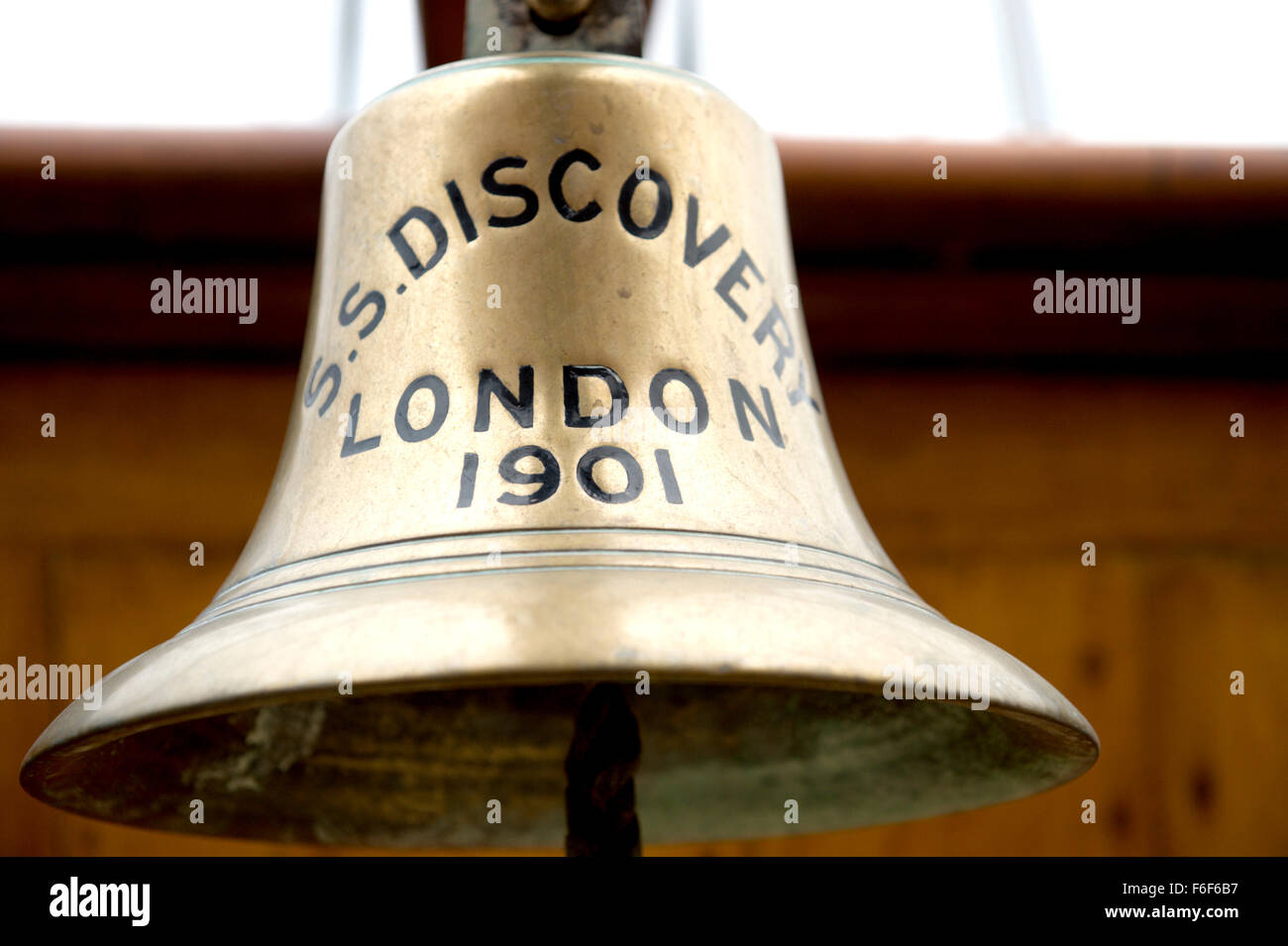 The brass ships bell on RRS Discovery Royal Research Ship moored at Discovery Point Dundee - Stock Image