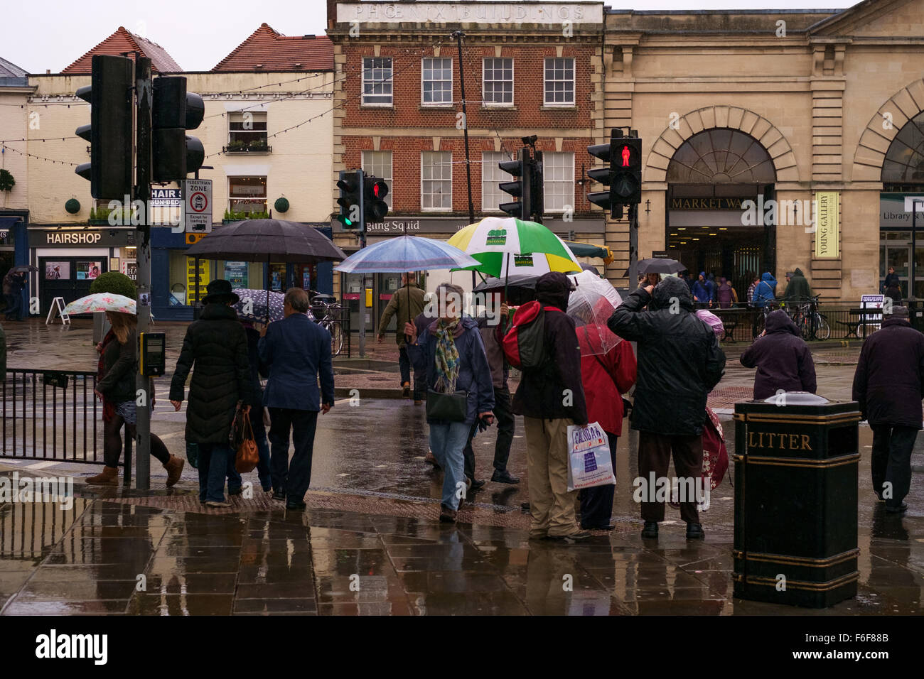 Uk Weather A Very Wet Day For Shopping In Salisbury With People Crossing The Road Using Umbrellas To Protect Them From Heavy Rain