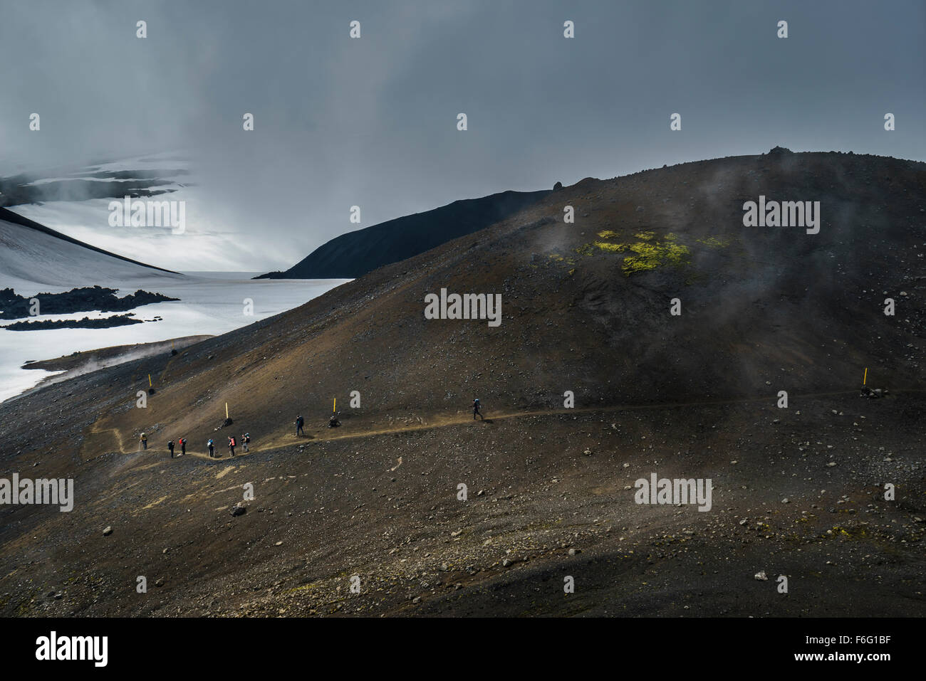 People walking by, Fimmvorduhals near Eyjafjallajokull glacier, Iceland - Stock Image