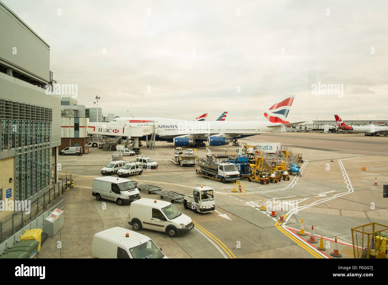 Heathrow Airport. British Airways planes on the apron ready to depart. - Stock Image