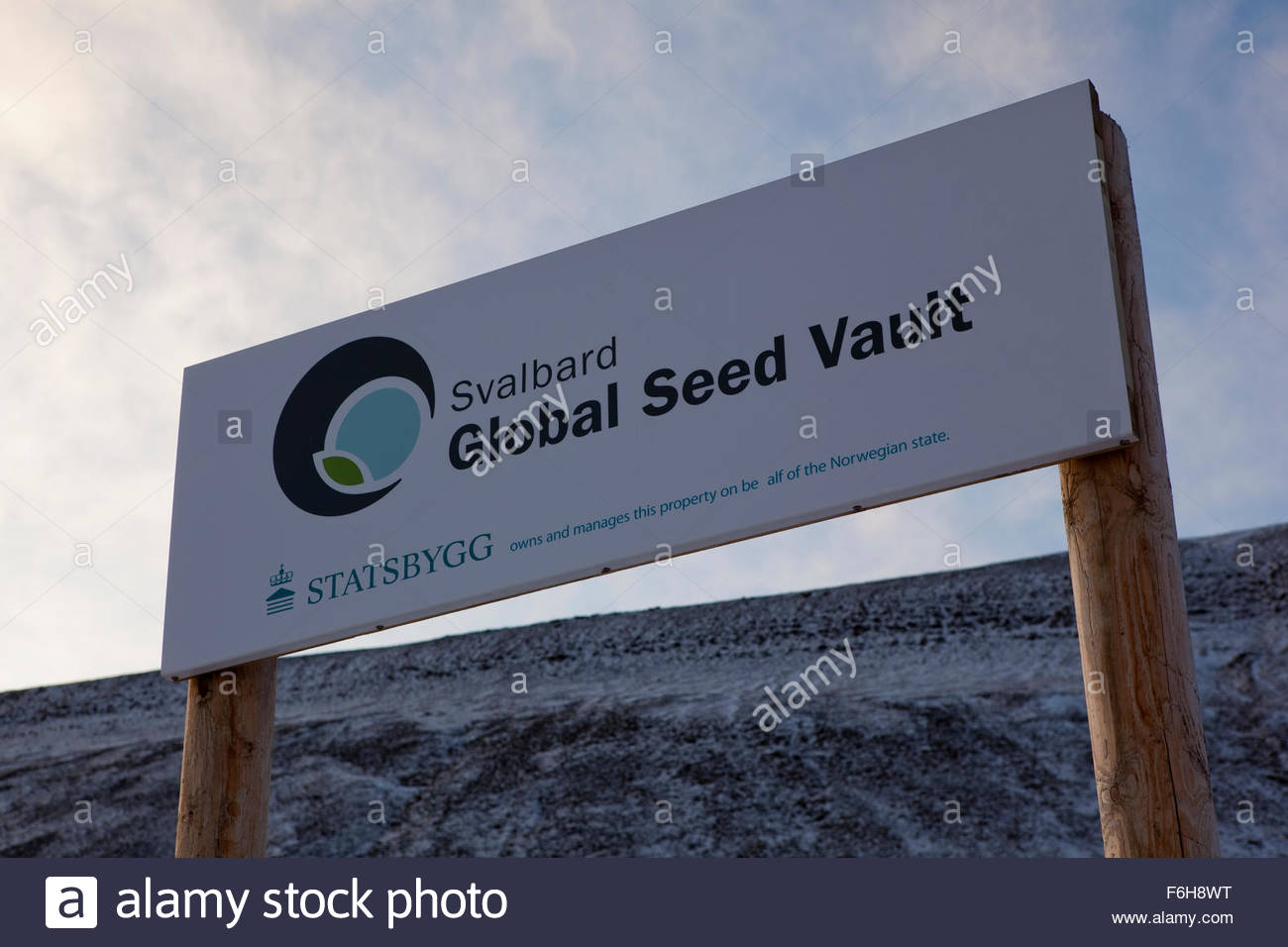 Sign outside the Svalbard Global Seed Vault. Nestled into the rocky waste of plataberget Mountain about Svalbard's Stock Photo