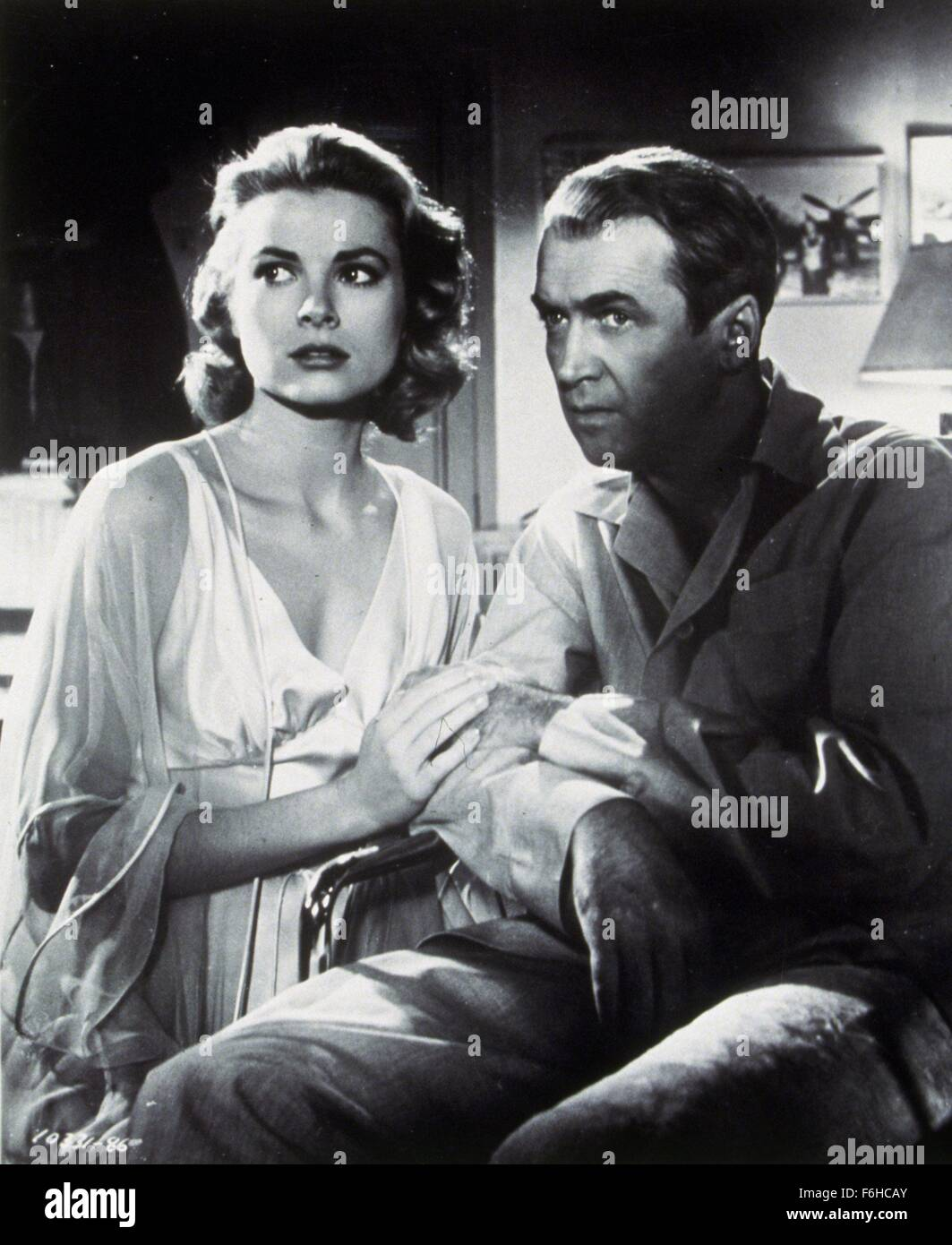 1954, Film Title: REAR WINDOW, Director: ALFRED HITCHCOCK, Studio: PARAMOUNT, Pictured: ALFRED HITCHCOCK, GRACE - Stock Image
