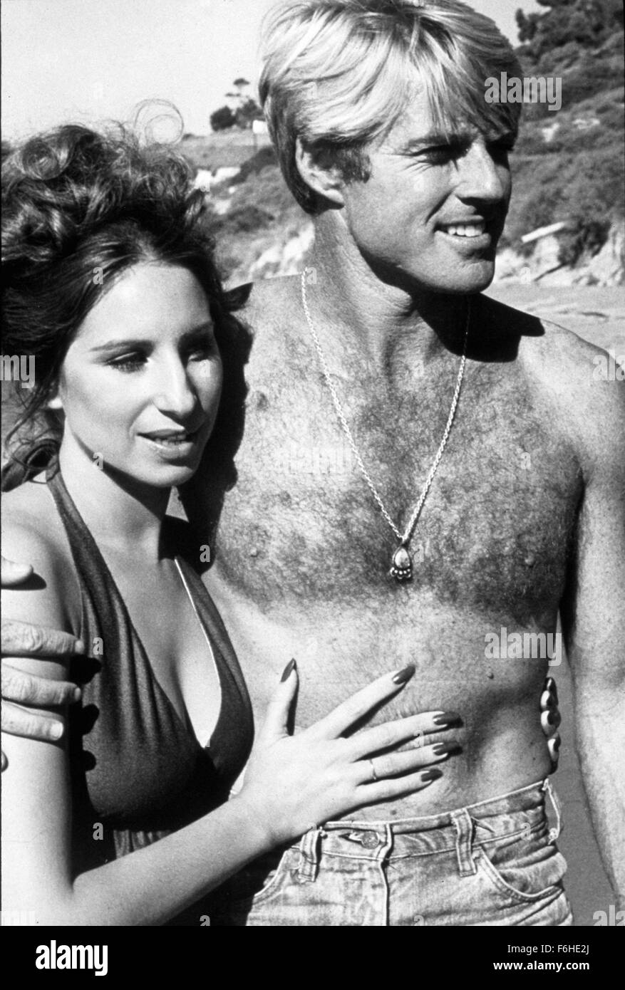 1973, Film Title: WAY WE WERE, Director: SYDNEY POLLACK, Studio: COLUMBIA,  Pictured: BARE CHEST, BEACH, BEEFCAKE, BODY PART, SYDNEY POLLACK, ROBERT  REDFORD.