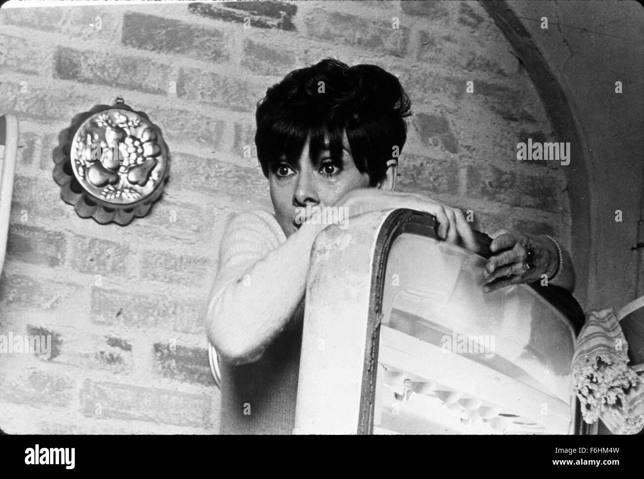 1967, Film Title: WAIT UNTIL DARK, Director: TERENCE YOUNG, Studio: WARNER, Pictured: AUDREY HEPBURN, HIDING, FEAR, - Stock Image