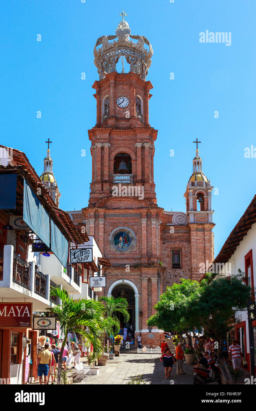 The Church of Our Lady of Guadalupe with its ornate spire and crowned top, El Centro district, Puerto Vallarta, - Stock Image