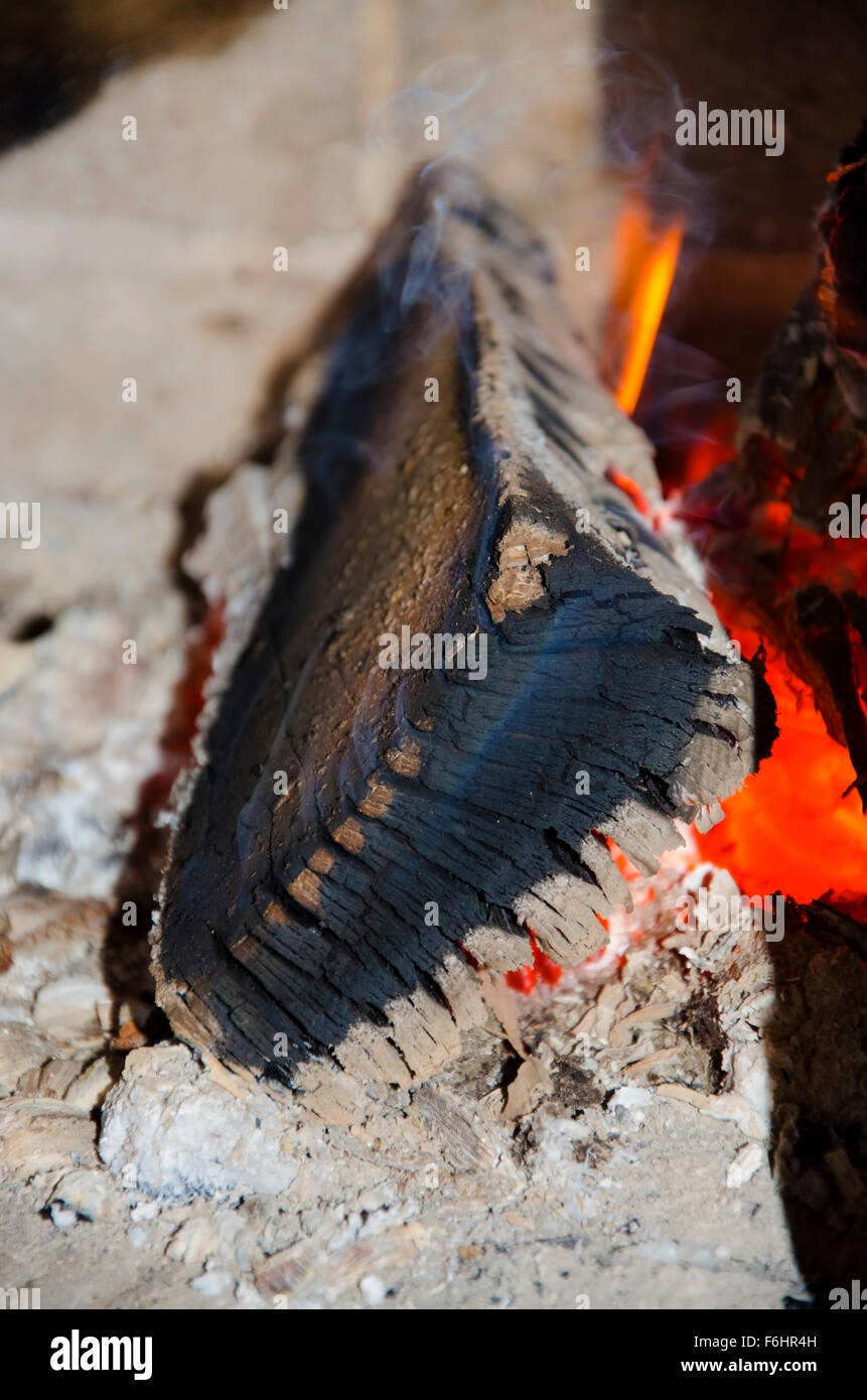 Christmas Eve log burning in a fireplace - Stock Image
